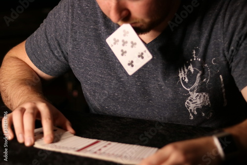 Tableau sur Toile card magician practicing sleight of hand magic card in mouth