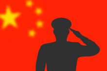 Solder Silhouette On Blur Background With China Flag.