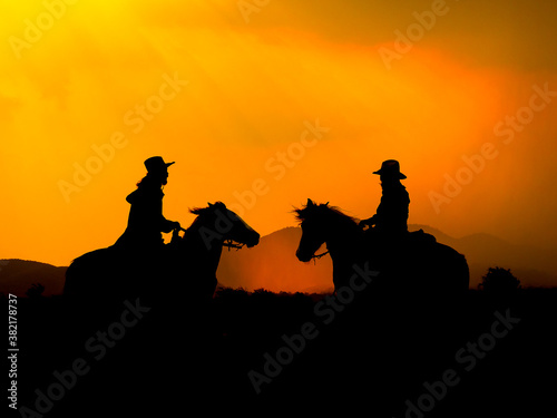 The Western Cowboy forced his horses to stop while the sun was setting, In lands Canvas