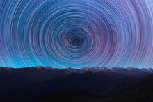 Long Exposure Night Landscape. Beautiful Mountains And. Colorful Star Trails On The Sky. Night Time Lapse Photography.