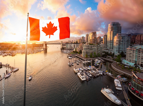 Canadian National Flag Overlay. False Creek, Downtown Vancouver, British Columbia, Canada. Beautiful Aerial View of a Modern City on the West Pacific Coast during a colorful bright Sunset.