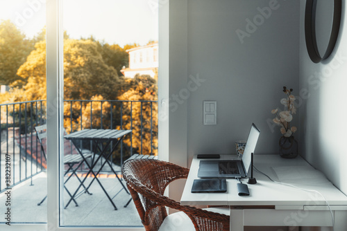 Leinwand Poster An interior of a cozy room with a desktop and a laptop on it with a USB hub and
