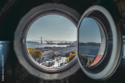 View through the round window of an antique house of Lisbon cityscape in the bac Fototapeta