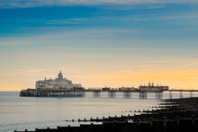 View Along The Beach To Eastbourne Pleasure Pier, Eastbourne, East Sussex, England, United Kingdom