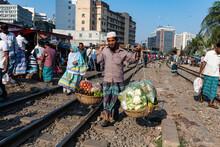 Street Vendor On The Railway Tracks Going Through Kawran Bazaar, Dhaka