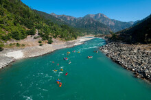 Rafts And Kayaks Drift Down Th...
