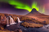 Aurora Borealis (Northern Lights) over Kirkjufell Mountian with a small waterfall in Iceland, Polar Regions