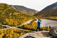 Photographer Taking Landscape ...