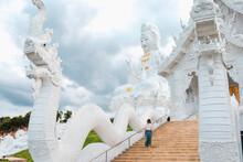 Woman Traveller Visiting A Temple In Chiang Rai, Thailand.