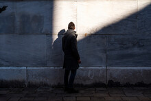 Man Against A Wall During A Su...