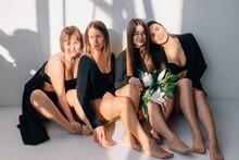 Four Girlfriends In Black Posi...