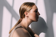 Blond Woman With Face In Shadow