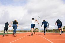 Teenagers Running Race On Stad...