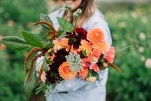 Woman Holding Beautiful Flower...