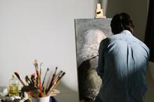 Male Artist Woking In Studio