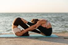 Slim Women Practicing Acro Yog...