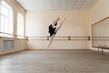 Ballerina Doing Split In Air
