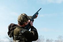 Hunter Aiming Gun At Sky
