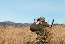 Huntsman Using Binoculars In D...