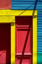 Brightly Colored Building In La Boca Neighborhood In Buenos Aires, Argentina