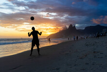 Man Playing Soccer In Ipanema ...