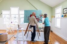 Senior Man Painting In Home Ar...