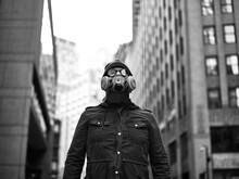 Man Wearing Gas Mask In City