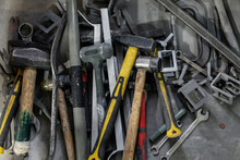Heap Of Shabby Tools In Workshop