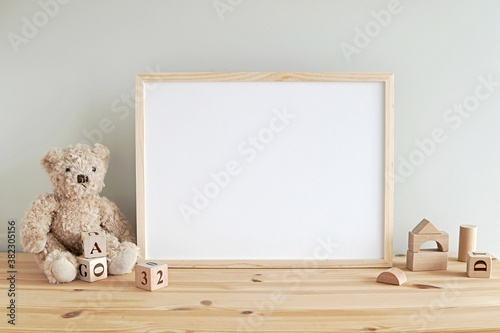 Fototapeta Nursery frame mockup, empty wooden horizontal frame for baby room or kids room wall art, print, photo. obraz