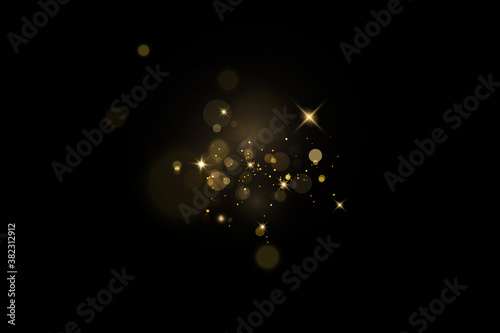 Fototapeta Glow light effect. Vector sparkles on a transparent background. Christmas light effect. Sparkling magical dust particles.The dust sparks and golden stars shine with special light. obraz
