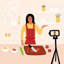 Food Blogger. Female Chef Poses In The Kitchen While Recording Video Using Camera Online Video Channel. Cook Healthy Food At Home. Homemade Meals. Culinary Video Master. Vector.