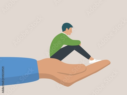 Photo A young male character sitting on a hand palm, psychotherapy, help and support,