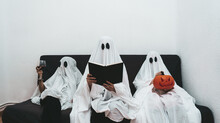 Trio Of Halloween Ghosts Sitti...
