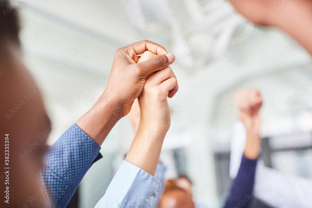 Fototapeta Business people hold hands for trust