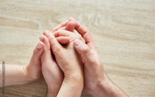 Fototapeta Hands touch as a sign of love and comfort obraz