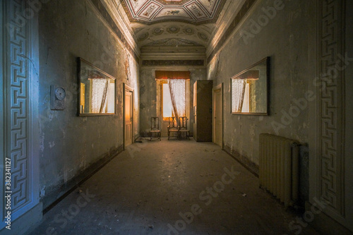 Fototapeta empty corridor with paintings in abandoned house