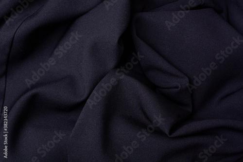 Obraz na plátně Black fabric folds background