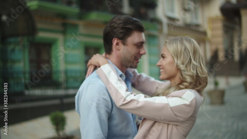 Fototapeta Business couple looking at each other outside. Love couple hugging at date obraz