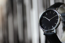 Black Wristwatch, With Chrome Dial. And Blurry Background