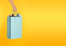 Woman Holding Paper Shopping B...