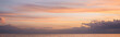 canvas print picture - Panoramic shot of sea and cloudy sky at sunset