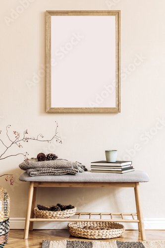 Design scandinavian home interior of living room with mock up poster map, stylish wooden bench, plaid, book, rattan decor and elegant accessories. Beige wall. Modern home staging. Template. Japandi.