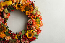 Beautiful Autumnal Wreath With Flowers, Berries And Fruits On Light Grey Background, Top View. Space For Text