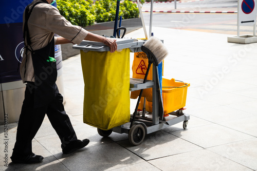 Fototapety, obrazy: man worker  working with janitorial, cleaning equipment and tools for floor cleaning.