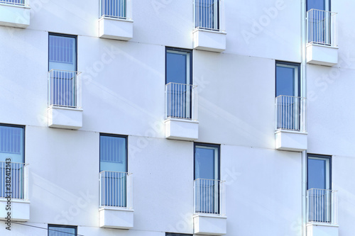 Obraz na plátně The French balconies on the modern white facade of the apartment building