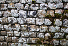 A Dry Stone Wall With Lichen G...