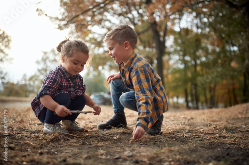 Fotografering Brother and sister playing in the woods; Healthy childhood concept