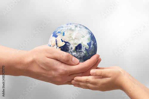 Obraz Earth globe in hands. World environment day. Elements of this image furnished by NASA - fototapety do salonu