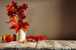 Leinwandbild Motiv Autumn table with colorful leaves on an afternoon day