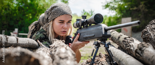Fotografie, Obraz Female soldier shooting with sniper rifle